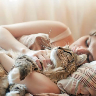 How can I stop my cat from waking me up at night?